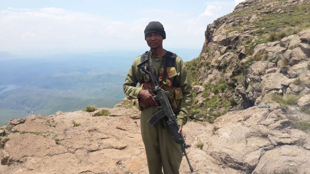 A guard from Lesotho with an assault rifle on duty at the plateau. At least the safety catch seems to be on.